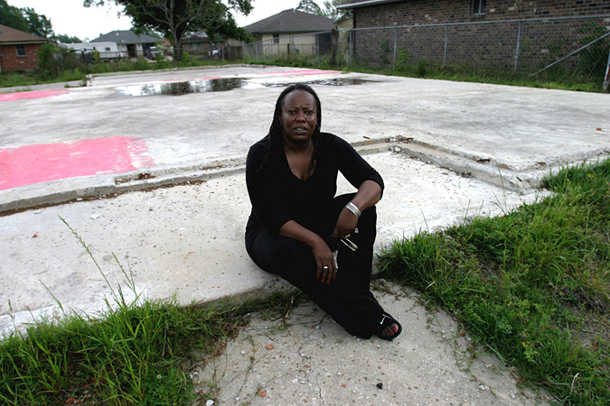 Ann Gaines sits on vacant foundation