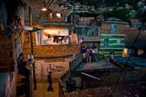 people on balconies and rooftops in Medellin, Colombia