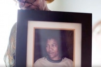 Woman holding a framed photo