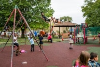 Children on swings at a playground