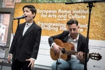 Boy singing at microphone
