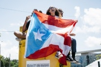 Students holding a Puerto Rican flag