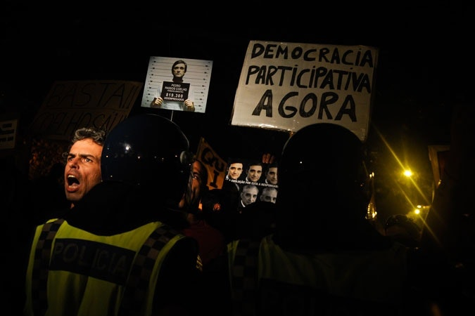 Man shouting at protest in Portugal.