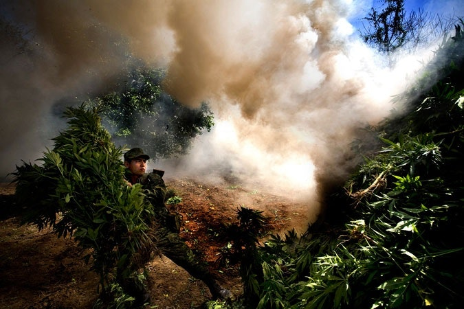 Solider burning Marijuana.
