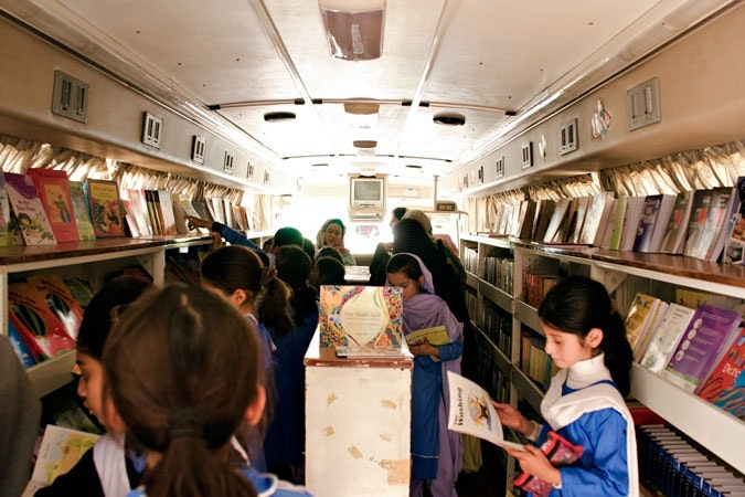 Children reading in mobile library.