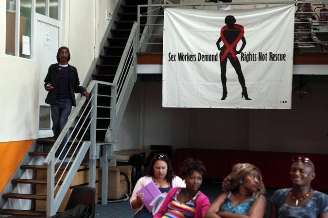 A transgender walking down stairs.