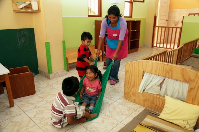 A woman playing with children