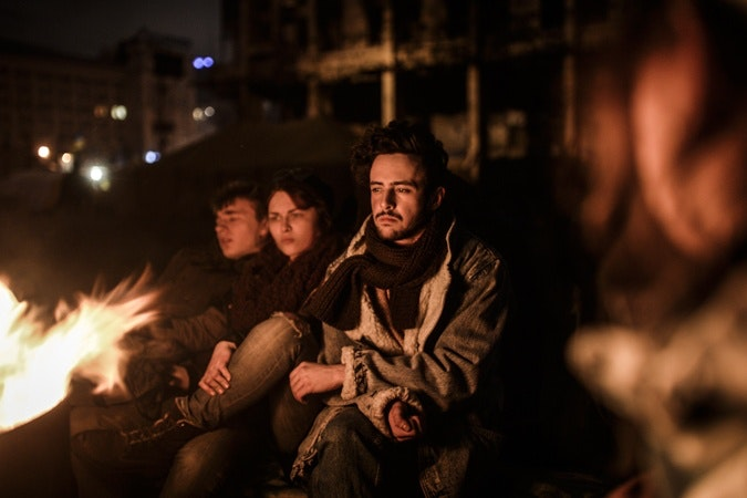 Ukraine youths by fire