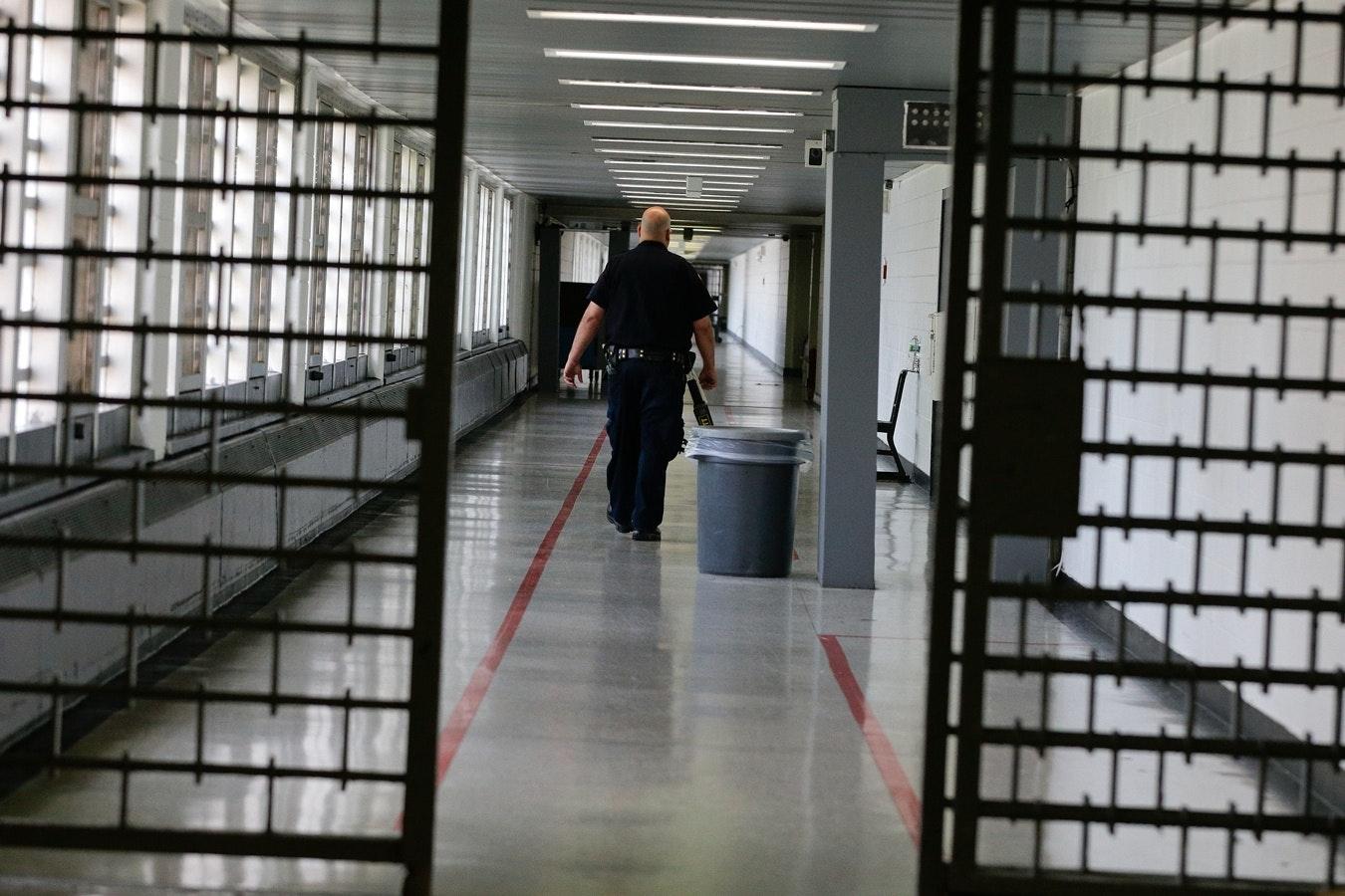 A man walking in a corridor.