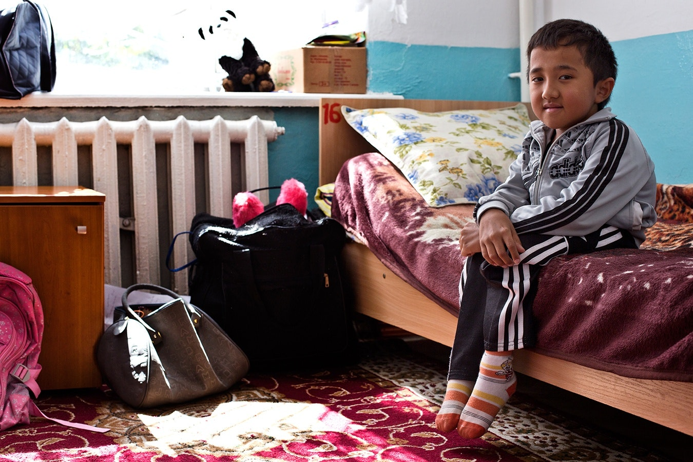 A young boy on his bed