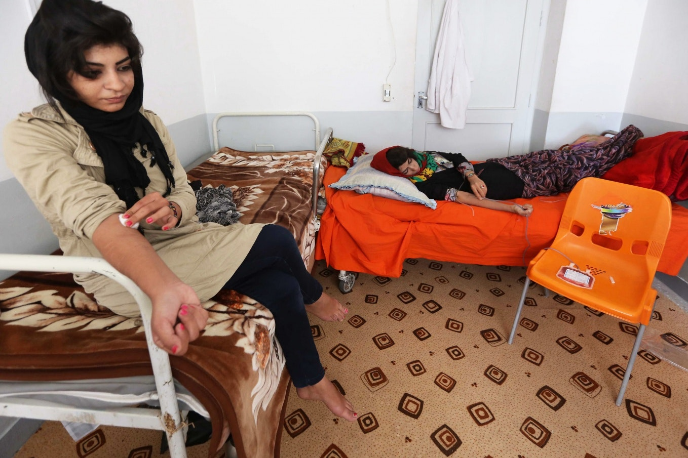 women donate blood in a clinic
