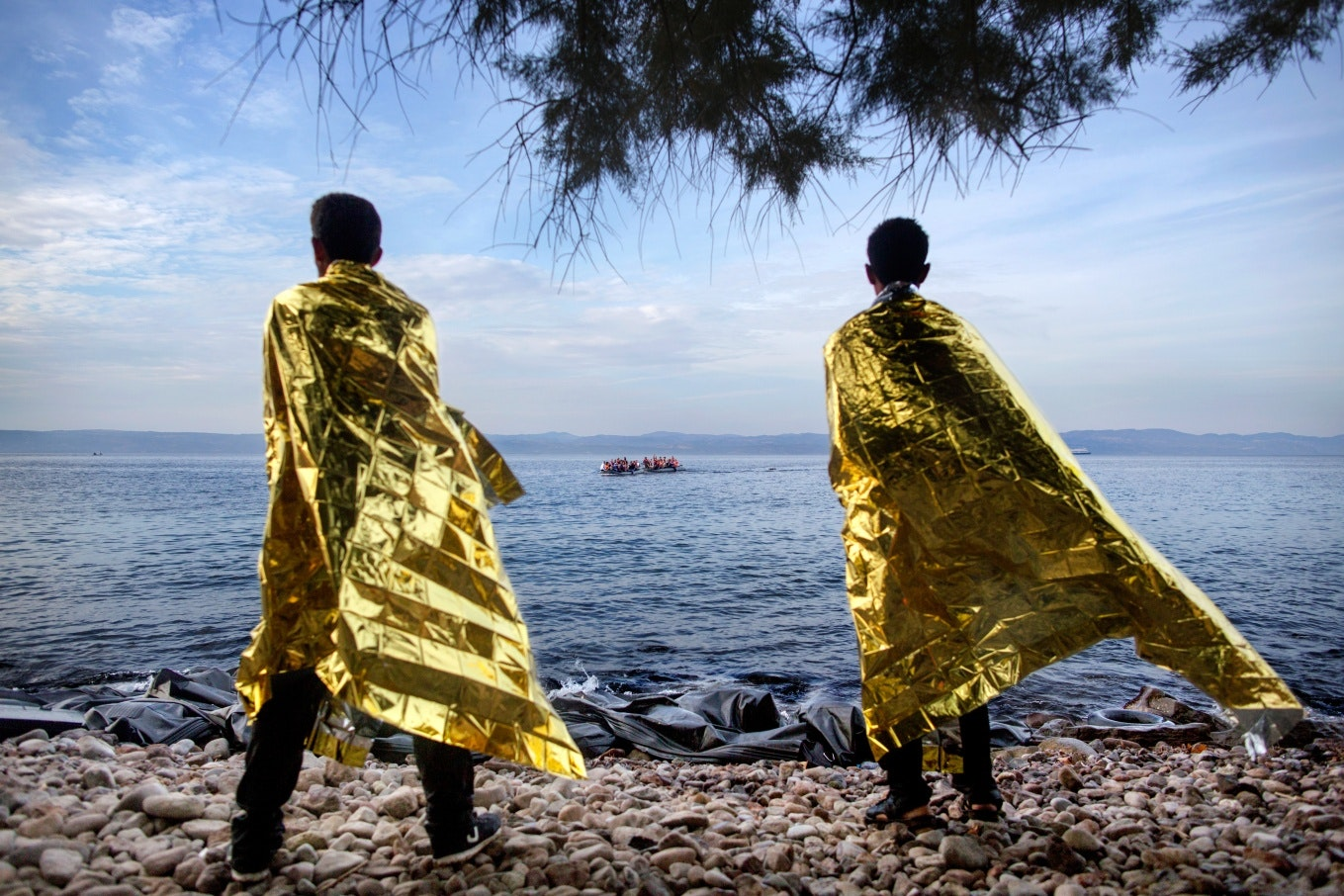 Two people wrapped in gold blankets