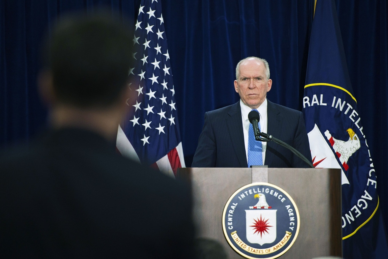 John Brennan at a podium