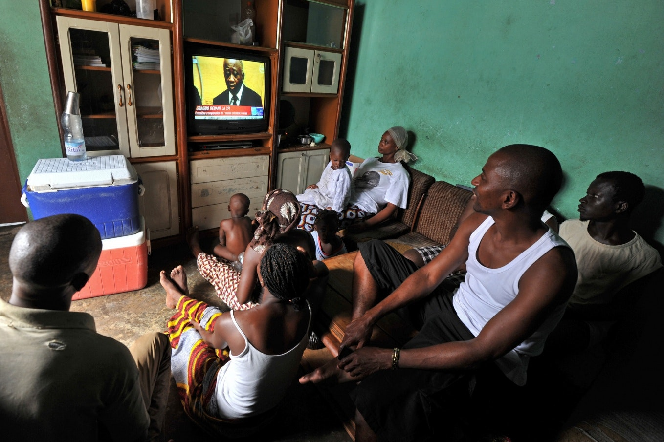 A family watching TV news
