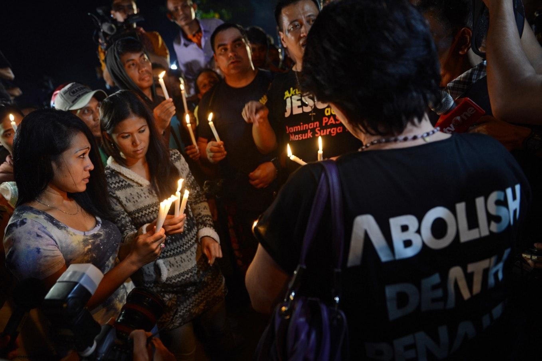 Protestors lighting candles