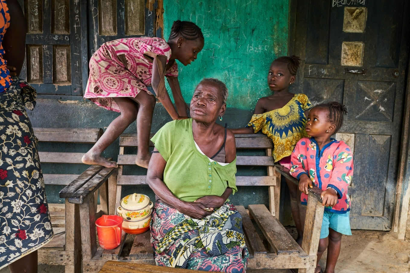 An elderly woman surrounded by children