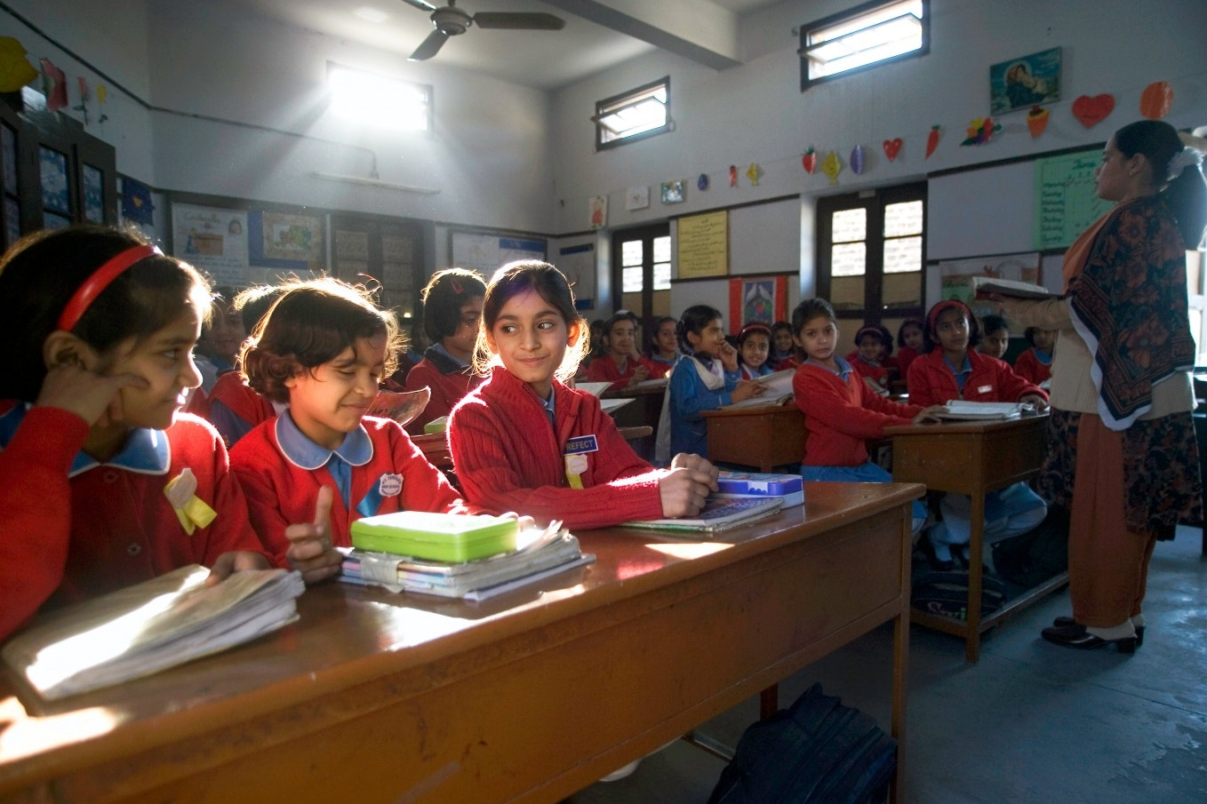 Children seated in a classroom