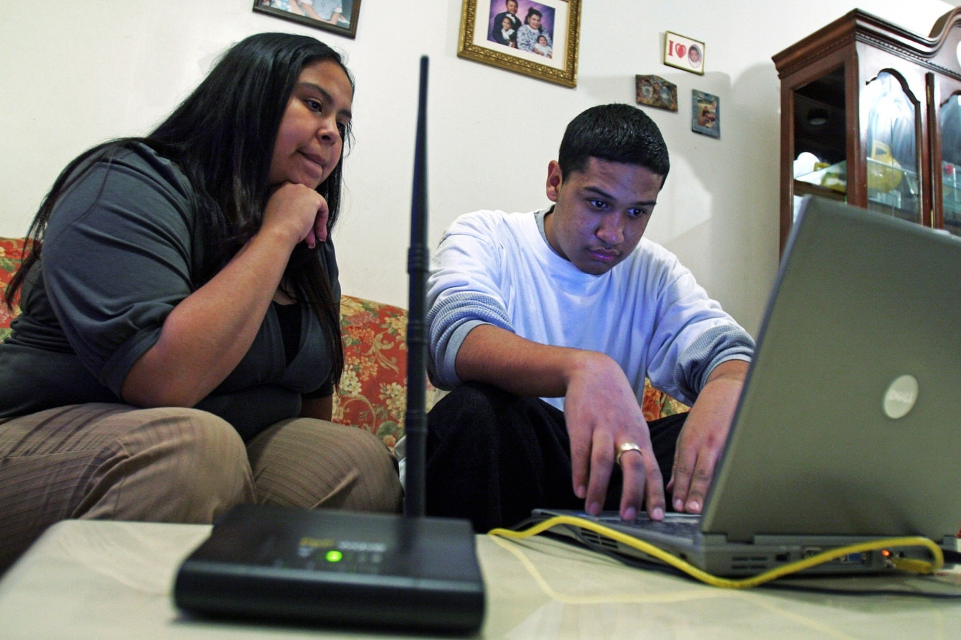 Two people in front of a laptop computer