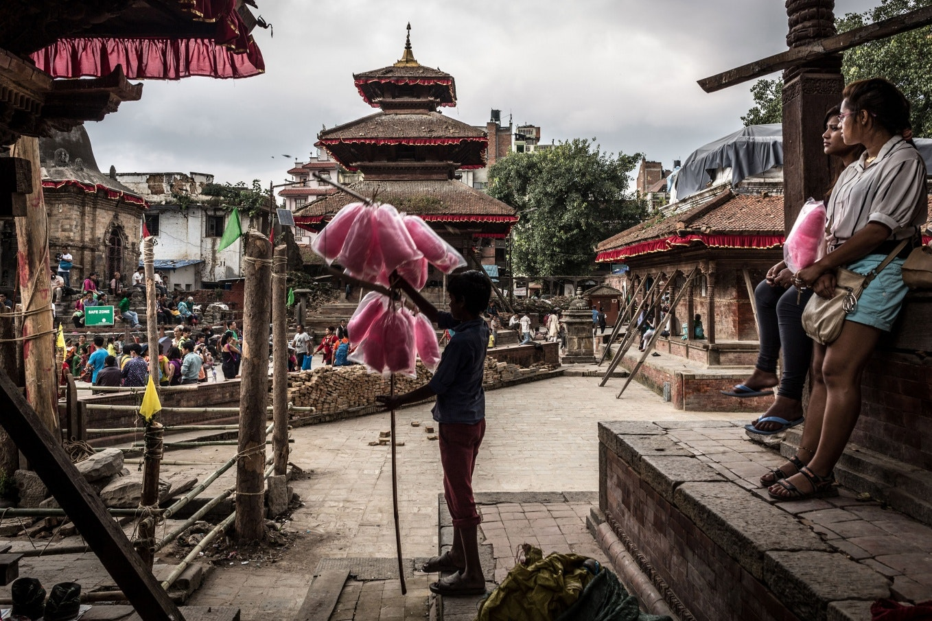 People surrounded by temple buildings