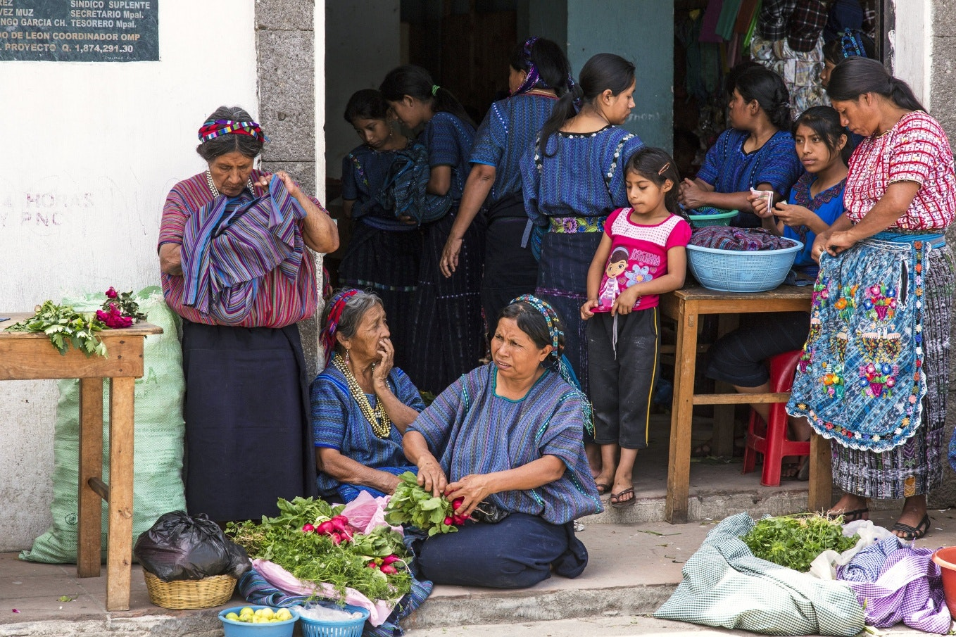 Women in traditional dress with radishes
