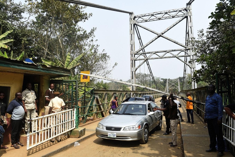 A car driving over a bridge