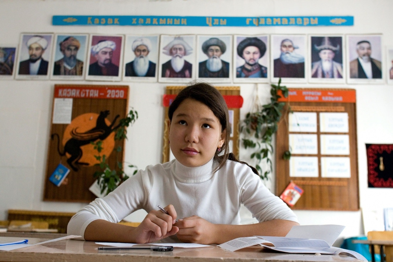 A girl sits in a classroom