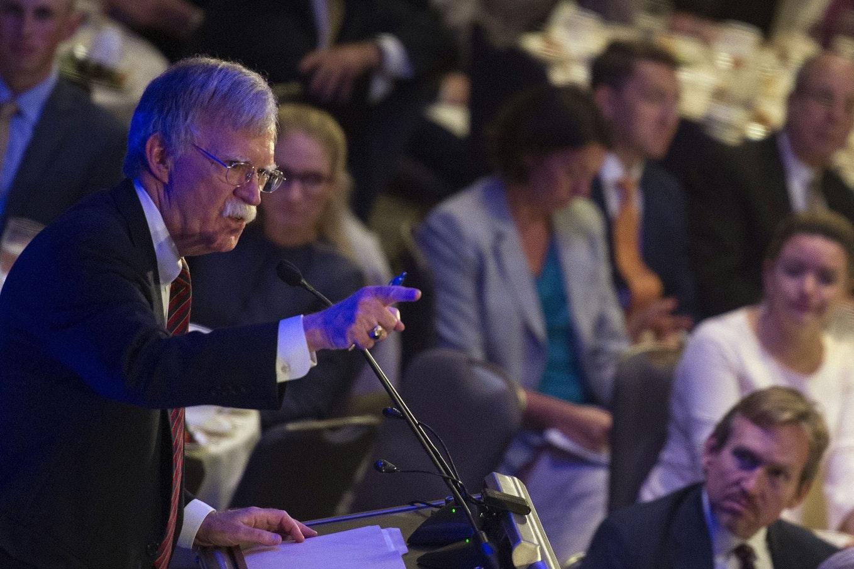 John Bolton at a podium