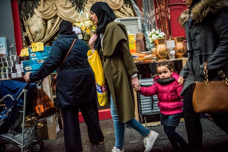 Women walking past a shop