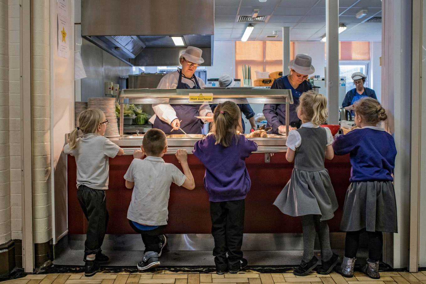 Children and staff in a cafeteria