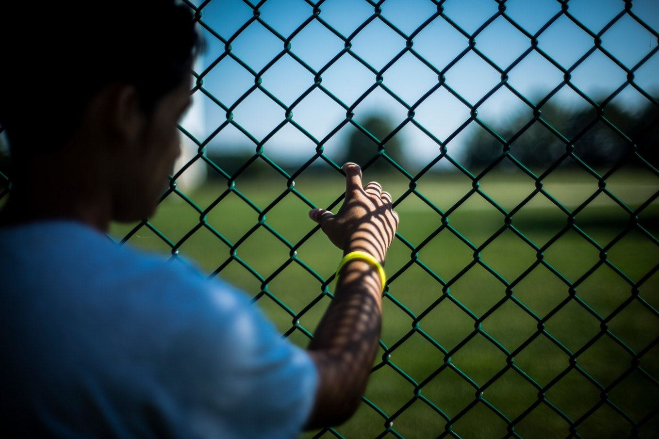 A hand on a chain link fence