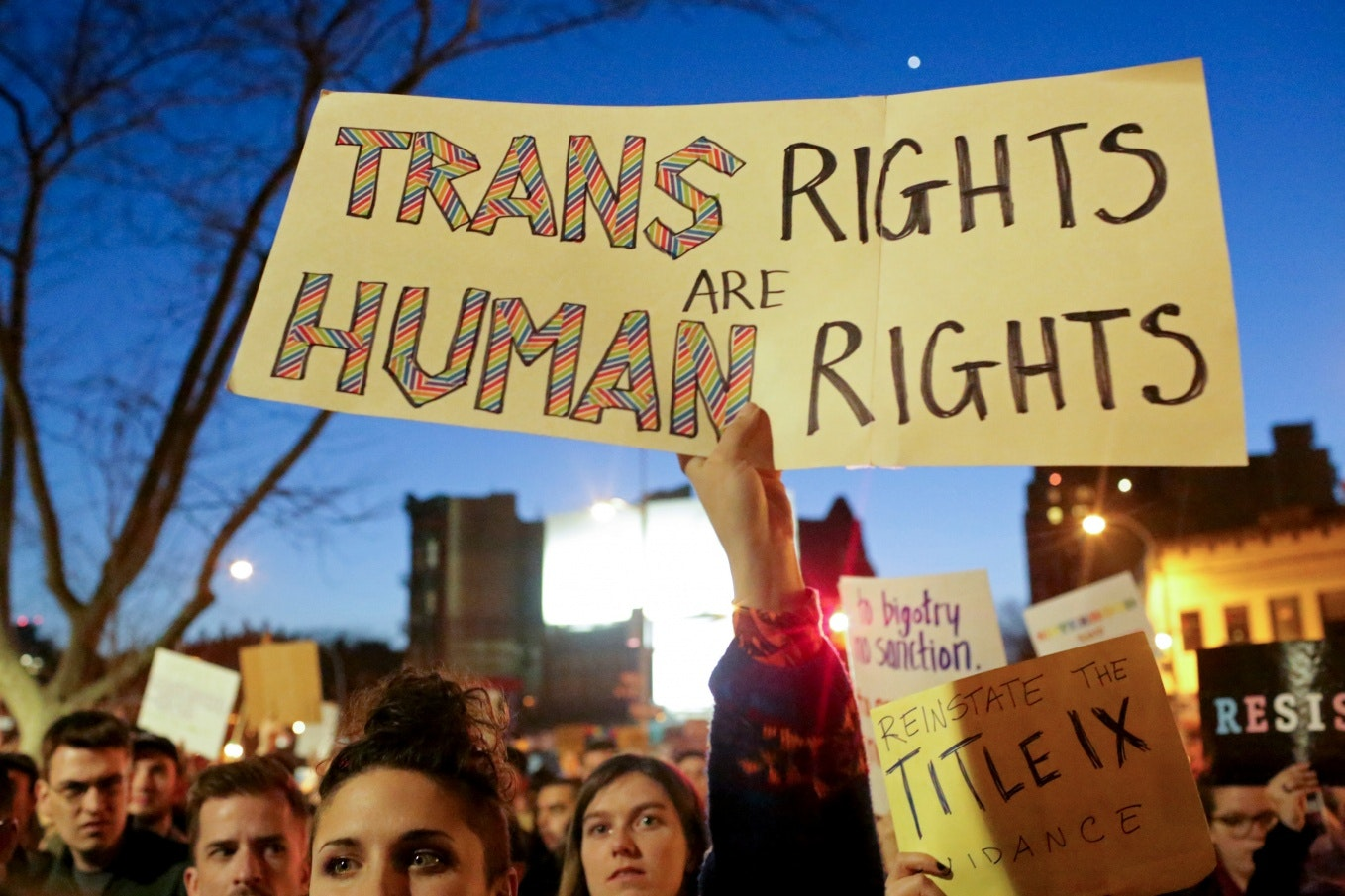 "A demonstrator holding a sign that says; ""Trans Rights Are Human Rights"""