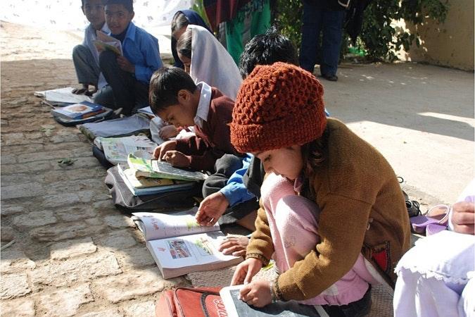 Children doing schoolwork.