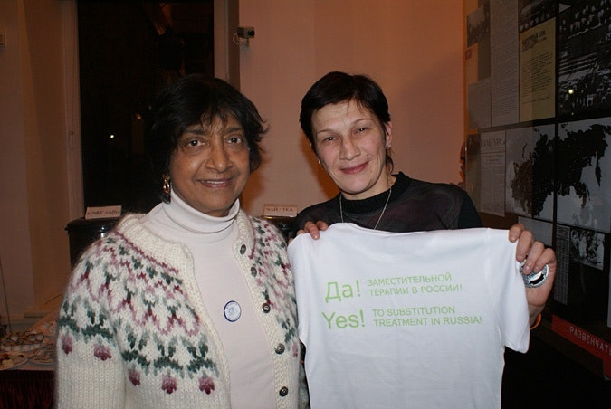 Two HIV activists; one holds a T-shirt