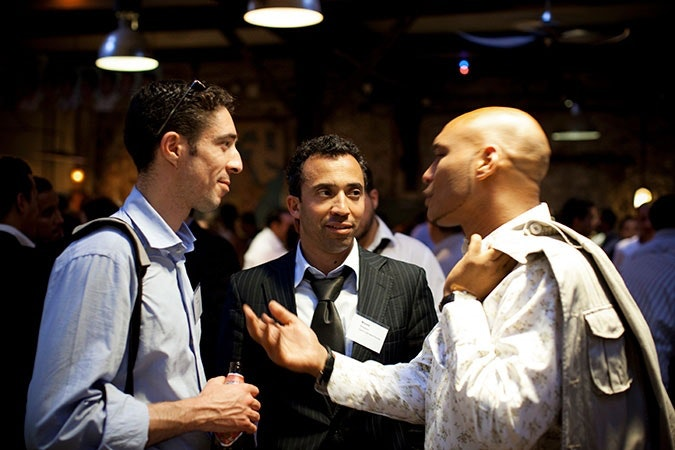 Professional men at networking event.