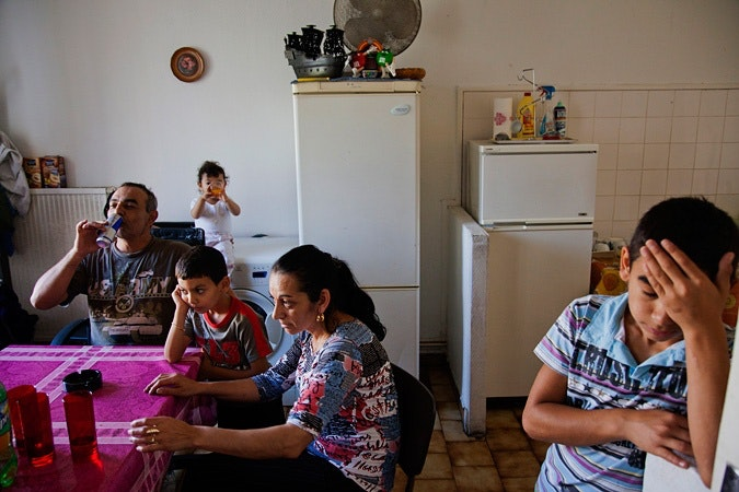 A family in a kitchen