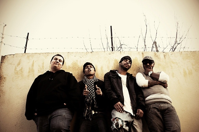 Four members of a Roma rap group.