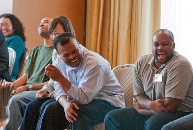 James Logan laughs with others at a Campaign for Black Male Achievement retreat