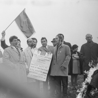 A group celebrating and holding a flag
