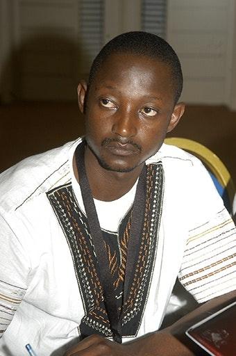 Frank Musukwa, man sitting