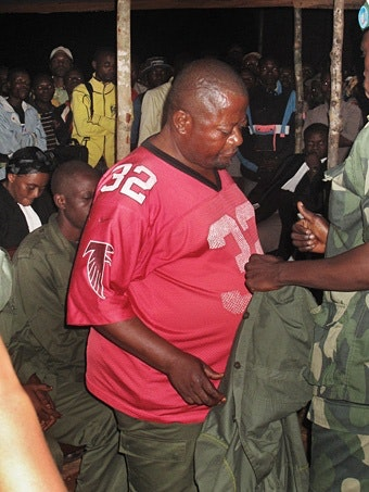 Bwana Ntambwe handing over his uniform
