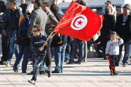Boy with a Tunisian flag