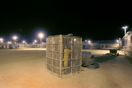 A prison yard at night