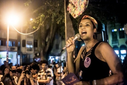 Marielle Franco with a microphone