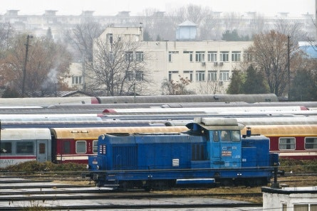 A railway yard with a building in the background