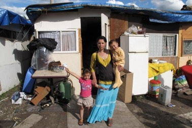 A Roma family before leaving the squatter camp