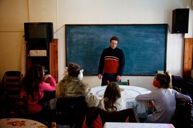Man standing in a room with children