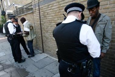 Police men searching two men