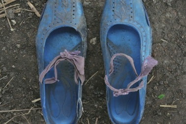A pair of worn shoes