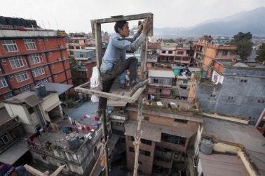 A man on a scaffolding