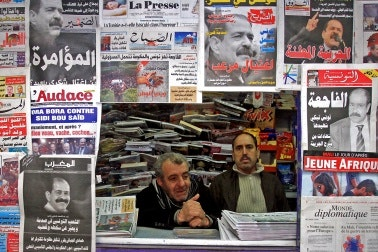 Two men in a newsstand